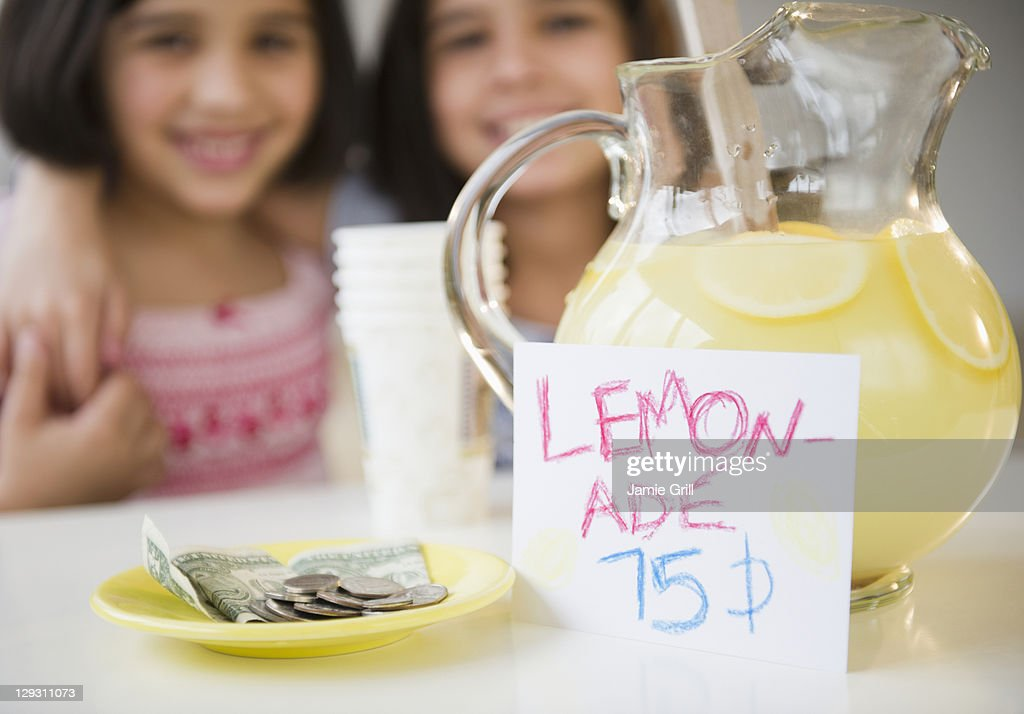 USA, New Jersey, Jersey City, Close up of two girl's (8-9, 10-11) selling lemonade : Stock Photo