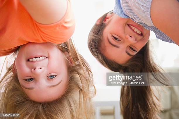 USA, New Jersey, Jersey City, Close up of two girls upside down