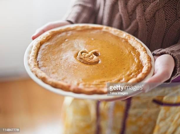 USA, New Jersey, Jersey City, close up of woman holding pumpkin pie