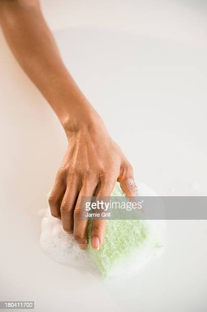 USA, New Jersey, Jersey City, Close up of woman's hand cleaning with sponge