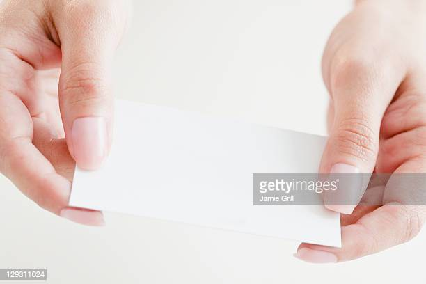 usa, new jersey, jersey city, close up of woman's hands holding credit card - 名刺 ストックフォトと画像