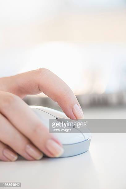 USA, New Jersey, Jersey City, Close up of woman's hands using computer mouse