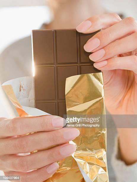 USA, New Jersey, Jersey City, Close-up of woman holding chocolate bar