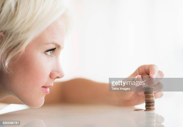 USA, New Jersey, Jersey City, Close-up of woman stacking coins
