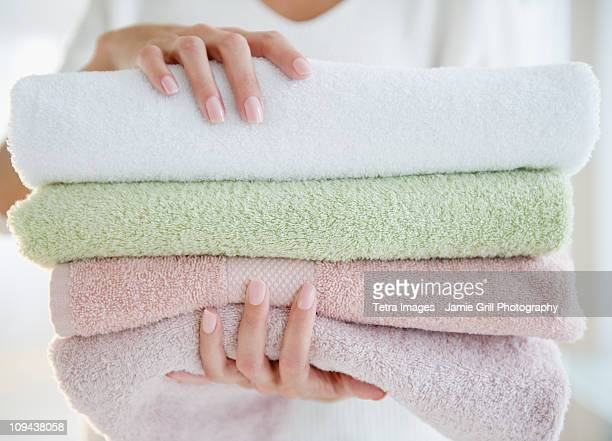 USA, New Jersey, Jersey City, Close-up view of woman holding fresh towels