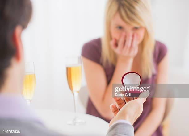 USA, New Jersey, Jersey City, Couple celebrating engagement in restaurant