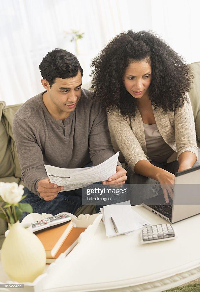 USA, New Jersey, Jersey City, Couple doing home finances : Stock Photo