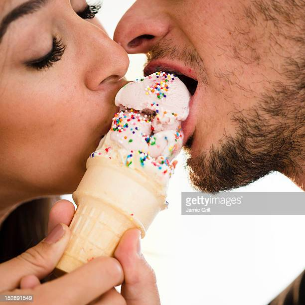 USA, New Jersey, Jersey City, Couple eating ice cream together