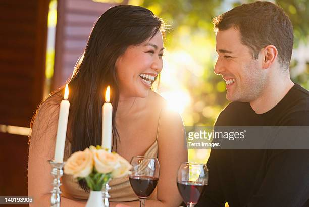 USA, New Jersey, Jersey City, Couple enjoying fine meal in restaurant
