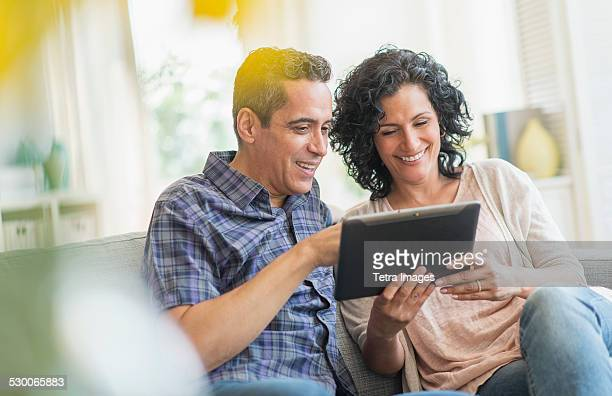 USA, New Jersey, Jersey City, Couple using digital tablet together