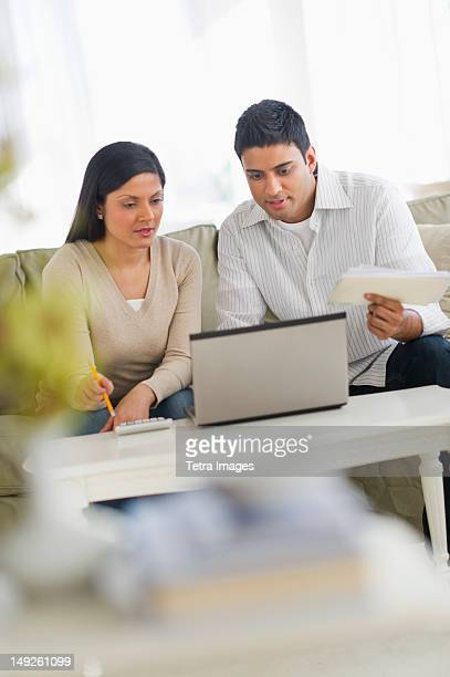 USA, New Jersey, Jersey City, Couple using laptop