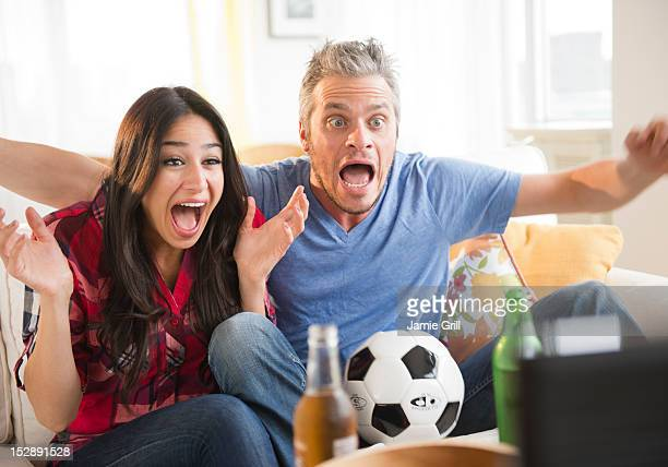 USA, New Jersey, Jersey City, Couple watching tv