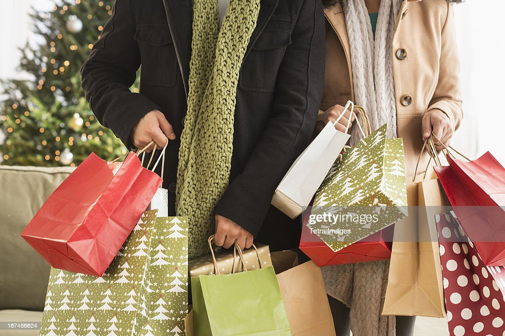 USA, New Jersey, Jersey City, Couple with Christmas shopping : Stock Photo