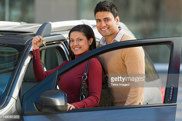 usa, new jersey, jersey city, couple with new car - new jersey stock pictures, royalty-free photos & images