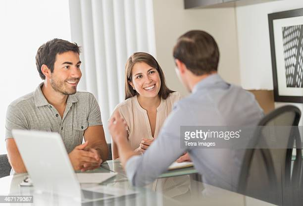 USA, New Jersey, Jersey City, Customers talking to advisor in office