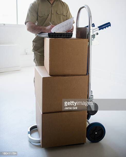USA, New Jersey, Jersey City, Delivery man filling documents