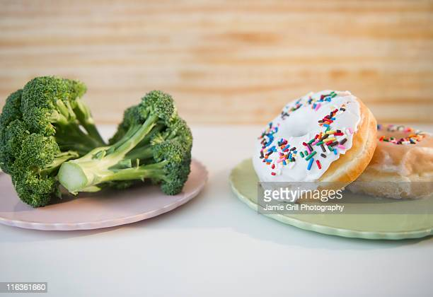 USA, New Jersey, Jersey City, donuts against broccoli