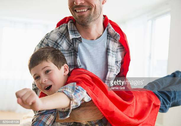 USA, New Jersey, Jersey City, Father and son (8-9) acting as super heroes