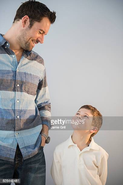 USA, New Jersey, Jersey City, Father and son (8-9) looking at each other