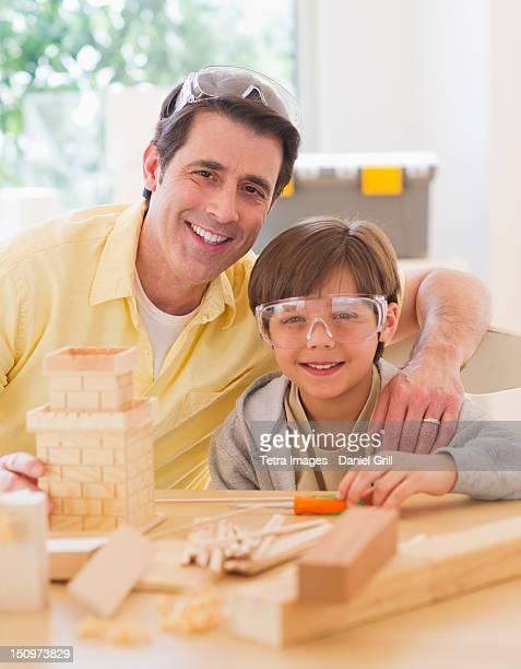 USA, New Jersey, Jersey City, Father constructing castle with son (10-11)