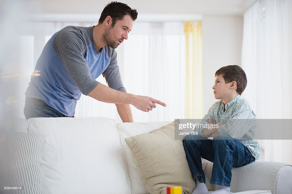USA, New Jersey, Jersey City, Father disciplining son (8-9) : Stock Photo