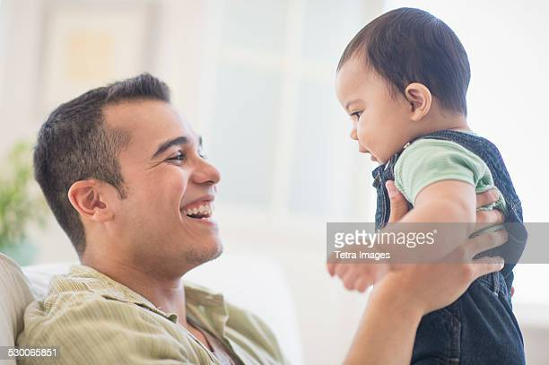 usa, new jersey, jersey city, father playing with his son (6-11 months) - 6 11 months stock pictures, royalty-free photos & images