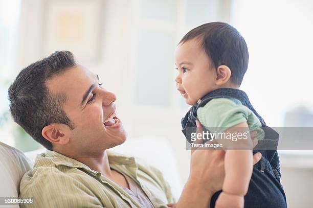 USA, New Jersey, Jersey City, Father playing with his son (6-11 months)