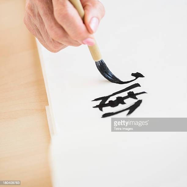 USA, New Jersey, Jersey City, Female hand and japanese calligraphy
