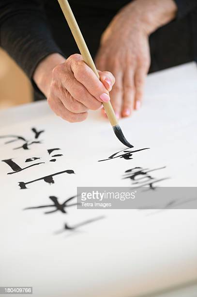 usa, new jersey, jersey city, female hands and japanese calligraphy - 書道 ストックフォトと画像