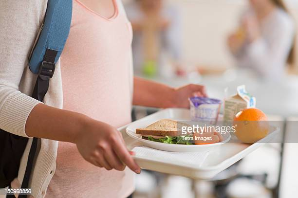 USA, New Jersey, Jersey City, Female student carrying tray in cafeteria