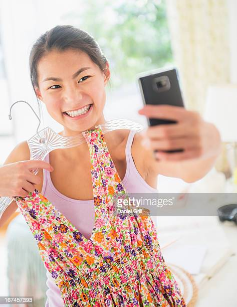 USA, New Jersey, Jersey City, Front view of teenage girl ( 16-17 years) taking photo of herself