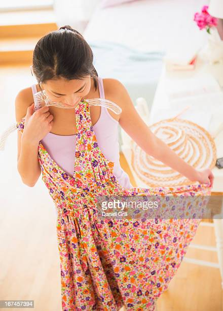 usa, new jersey, jersey city, front view of teenage girl ( 16-17 years) trying on dress - 16 17 years stock pictures, royalty-free photos & images