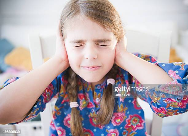 USA, New Jersey, Jersey City, Girl ( 6-7) covering ears