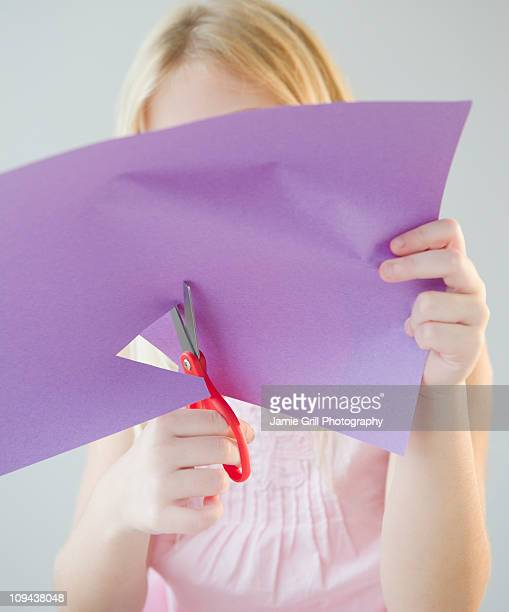 USA, New Jersey, Jersey City, Girl (8-9) cutting star shape in paper