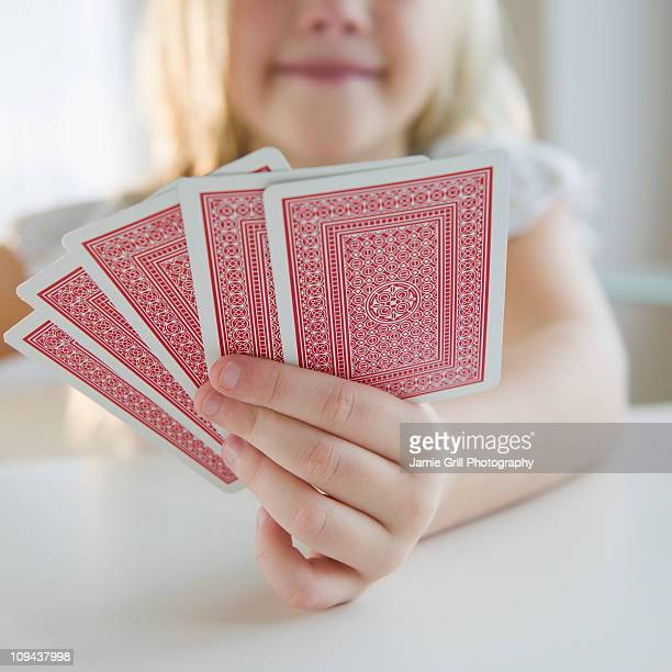 USA, New Jersey, Jersey City, Girl (8-9) playing cards