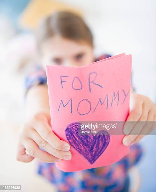 usa, new jersey, jersey city, girl ( 6-7) showing greeting card for mother's day - mothers day card ストックフォトと画像