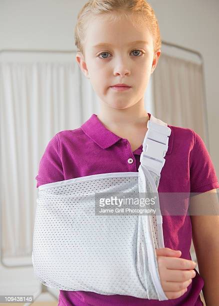 usa, new jersey, jersey city, girl (8-9) with hand in cast - cast colors for broken bones stock pictures, royalty-free photos & images