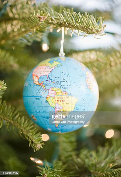 USA, New Jersey, Jersey City, Globe bauble on Christmas tree
