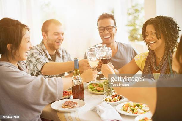 USA, New Jersey, Jersey City, Group of friends enjoying dinner party