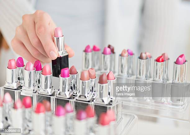 USA, New Jersey, Jersey City, Hand of woman choosing lipstick