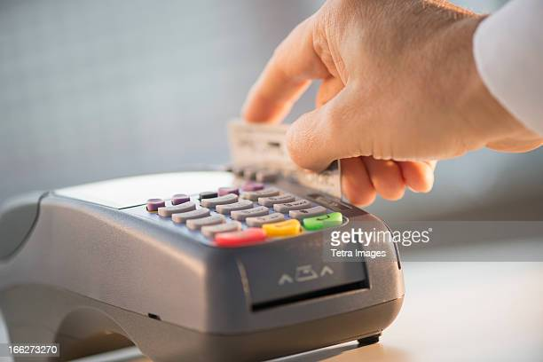 USA, New Jersey, Jersey City, Hand paying with credit card