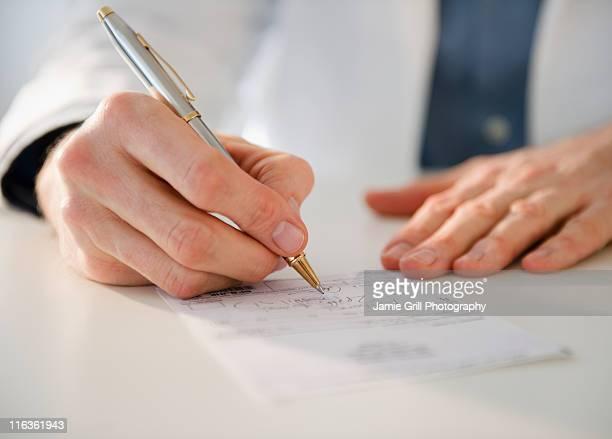 USA, New Jersey, Jersey City, hand writing prescription