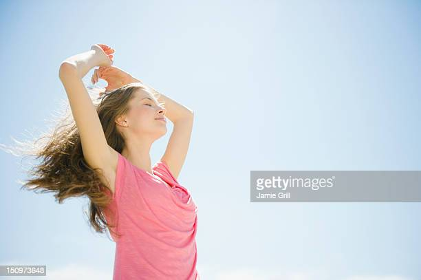 USA, New Jersey, Jersey City, Happy woman outdoors