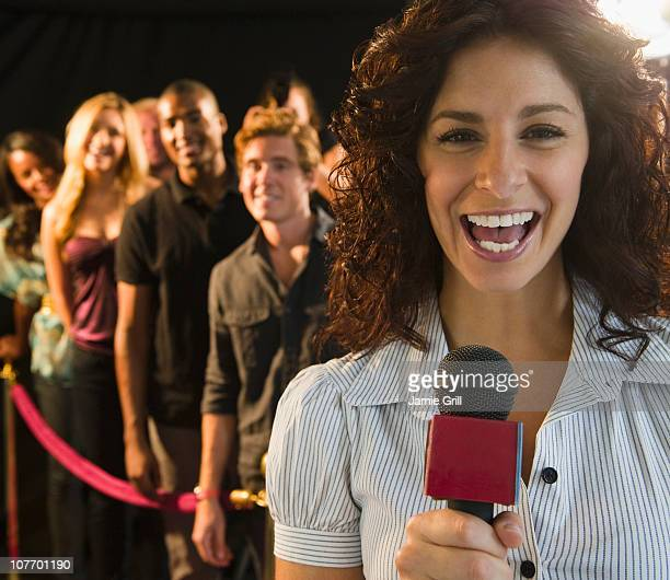 USA, New Jersey, Jersey City, Journalist talking at red carpet event