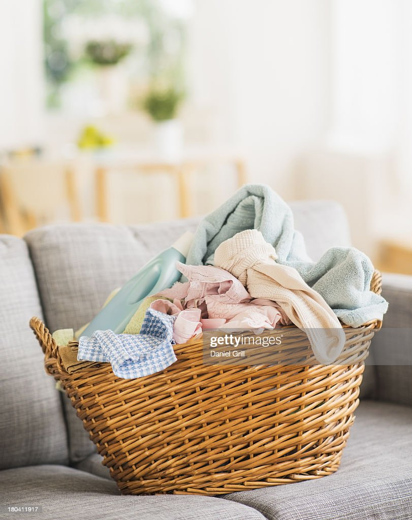 USA, New Jersey, Jersey City, Laundry basket on sofa : Stock Photo