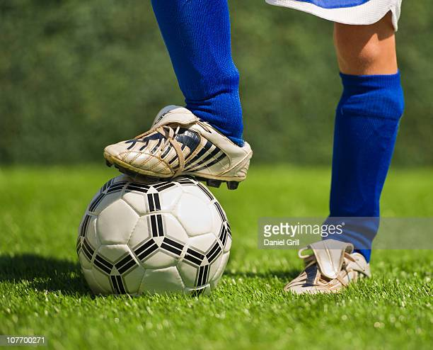 USA, New Jersey, Jersey City, Low section of boy (10-11) playing soccer