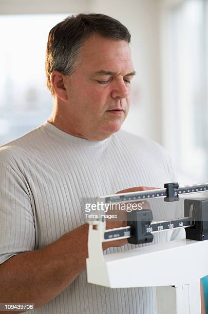 USA, New Jersey, Jersey City, Male patient on weighing scales in hospital