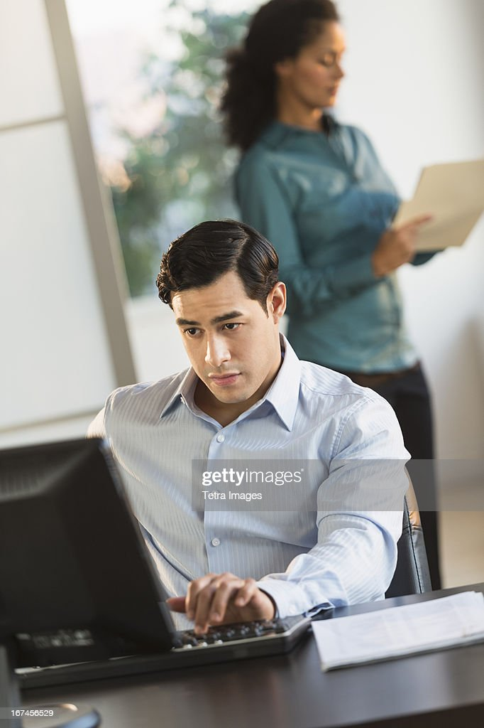 USA, New Jersey, Jersey City, Man and woman working in office : Stock Photo