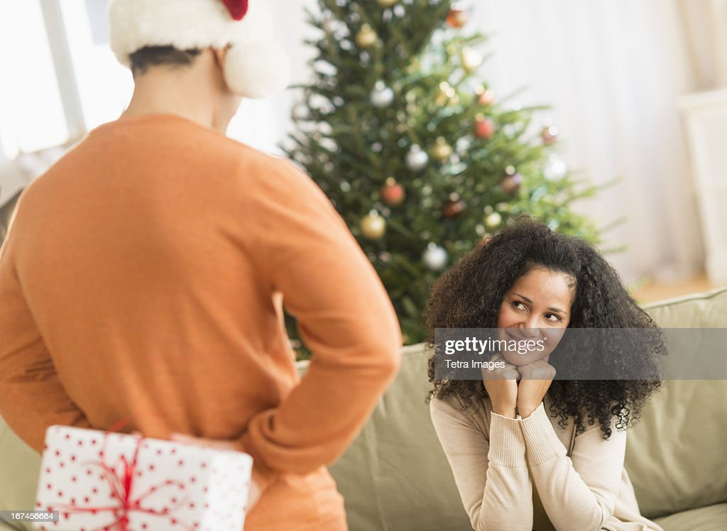 USA, New Jersey, Jersey City, Man holding Christmas gift for woman : Stock Photo