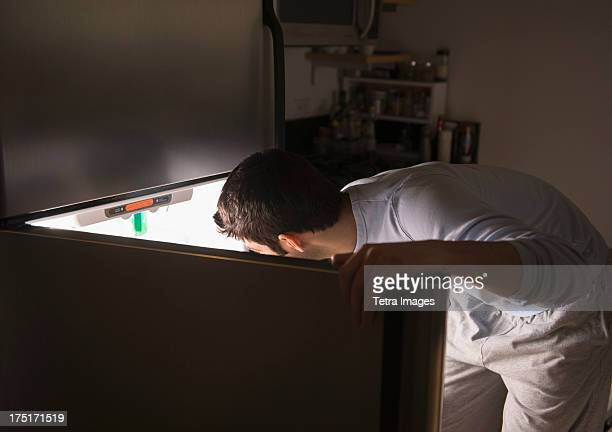 USA, New Jersey, Jersey City, Man opening fridge at night